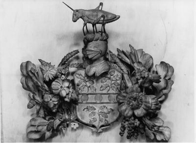 Arms of William Lynnet, by Grinling Gibbons (Wren Library)